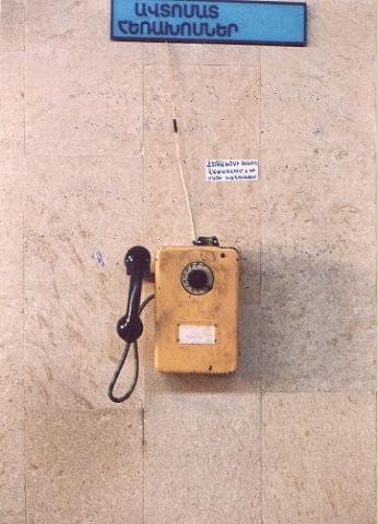 "This is a jeton operated phone in a Yerevan department store in Armenia.  I have no idea what the sign on the wall says.</BR></BR><span class=""date-display-single"" property=""dc:date"" datatype=""xsd:dateTime"" content=""1997-11-01T00:00:00+00:00"">Nov 01, 1997</span>"