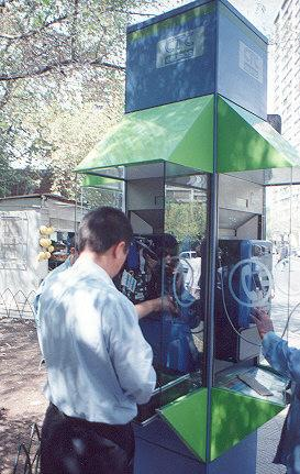 "Close up of technician working in CTC payphone.</BR></BR><span class=""date-display-single"" property=""dc:date"" datatype=""xsd:dateTime"" content=""1997-04-01T00:00:00+00:00"">Apr 01, 1997</span>"