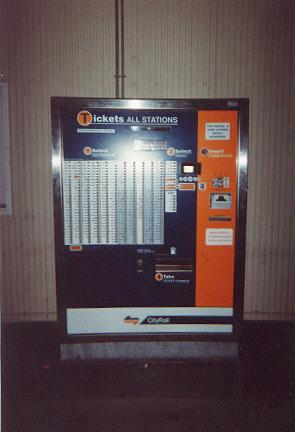 "A automatic ticket vendor at a railway station.  It is remotely programmed and monitored by armoured phone lines.</BR></BR><span class=""date-display-single"" property=""dc:date"" datatype=""xsd:dateTime"" content=""1995-11-02T00:00:00+00:00"">Nov 02, 1995</span>"